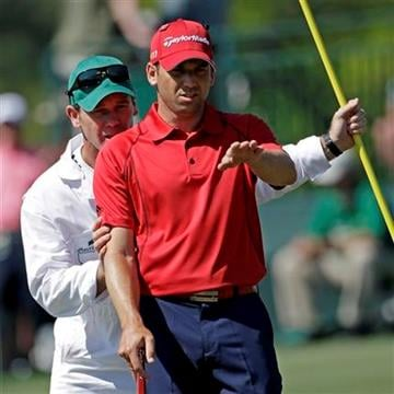 Sergio Garcia of Spain and caddie Gary Matthews look over a putt on the 17th hole during the first round of the Masters golf tournament Thursday, April 7, 2011, in Augusta, Ga. (AP Photo/David J. Phillip) By David J. Phillip