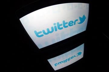 "The ""Twitter"" logo is seen on a tablet screen on December 4, 2012 in Paris. AFP PHOTO / LIONEL BONAVENTURE        (Photo credit should read LIONEL BONAVENTURE/AFP/Getty Images) By LIONEL BONAVENTURE"