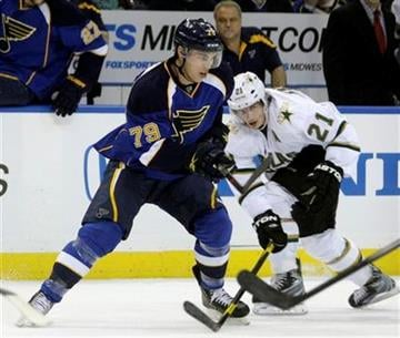 St. Louis Blues' Adam Cracknell (79) advances the puck past Dallas Stars' Loui Eriksson (21) in the second period of an NHL hockey game, Monday, Dec. 26, 2011 in St. Louis.(AP Photo/Tom Gannam) By Tom Gannam