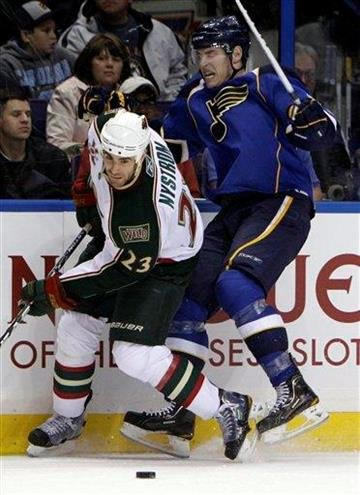 Minnesota Wild's Eric Nystrom, left, and St. Louis Blues' Adam Cracknell chase after a loose puck along the boards during the second period of an NHL hockey game, Tuesday, March 29, 2011, in St. Louis. (AP Photo/Jeff Roberson) By Jeff Roberson