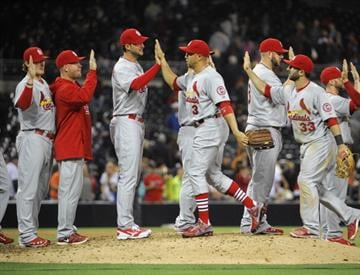 SAN DIEGO, CA - MAY 22:  St. Louis Cardinals players high-five after the Cardinals beat the San Diego Padres 5-3 in a baseball game at Petco Park on May 22, 2013 in San Diego, California.  (Photo by Denis Poroy/Getty Images) By Denis Poroy