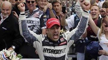 Tony Kanaan, of Brazil, celebrates after winning the Indianapolis 500 auto race at the Indianapolis Motor Speedway in Indianapolis, Sunday, May 26, 2013. (AP Photo/Darron Cummings) By Dan Mueller