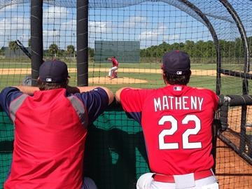 Michael Wacha throws some practice pitches as pitching coach Brent Lilliquist and head coach Mike Matheny watch. By Eric Lorenz