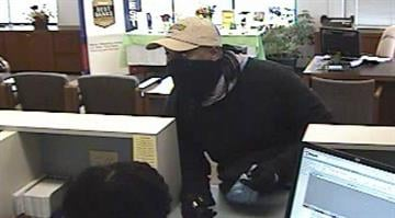 The photos show the suspect was wearing a bandana when he walked up to the front counter and pointed a gun at the teller and demanded money. By Belo Content KMOV