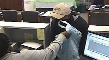 The teller can be seen handing the suspect a bag containing an unknown amount of cash. At one point the suspect's bandana falls off and his face is captured on surveillance cameras. By Belo Content KMOV