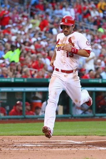 ST. LOUIS, MO - JUNE 3: Matt Carpenter #13 of the St. Louis Cardinals scores a run against the Arizona Diamondbacks in the first inning at Busch Stadium on June 3, 2013 in St. Louis, Missouri.  (Photo by Dilip Vishwanat/Getty Images) By Dilip Vishwanat