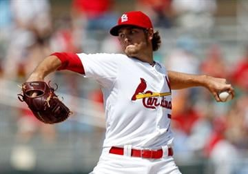 JUPITER, FL - MARCH 14:  Kevin Siegrist #77 of the St. Louis Cardinals pitches during a game against the Houston Astros at Roger Dean Stadium on March 14, 2012 in Jupiter, Florida.  (Photo by Sarah Glenn/Getty Images) By Sarah Glenn