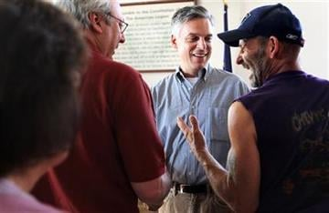 Republican 2012 presidential hopeful and former Utah Gov. Jon Huntsman, center facing, talks with local residents at a breakfast at American Legion Post 3 in Nashua, N.H., Saturday, Aug. 13, 2011.  (AP Photo/Cheryl Senter) By Cheryl Senter