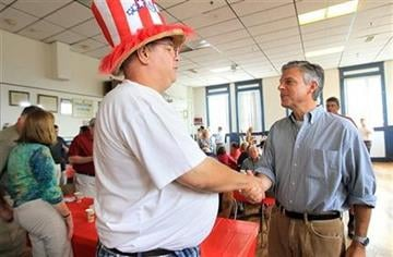 Michael Ewing, left, of Nashua, shakes hands with Republican 2012 presidential hopeful, Former Utah Gov. Jon Huntsman, right, at a breakfast at American Legion Post 3 in Nashua, N.H., Saturday, Aug. 13, 2011.  (AP Photo/Cheryl Senter) By Cheryl Senter