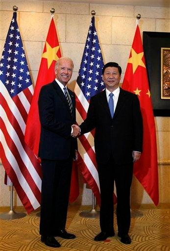 U.S. Vice President Joe Biden, left, poses for photos with Chinese Vice President Xi Jinping before their talks at a hotel in Beijing, China, Friday, Aug. 19, 2011. (AP Photo/Ng Han Guan, Pool) By Ng Han Guan