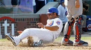 Chicago Cubs' Carlos Pena, left, scores past St. Louis Cardinals catcher Yadier Molina off a double by Geovany Soto during the eighth inning of a baseball game Friday, Aug. 19, 2011, in Chicago. (AP Photo/Charles Rex Arbogast) By Charles Rex Arbogast