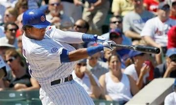 Chicago Cubs' Starlin Castro hits his 300th career hit off St. Louis Cardinals starting pitcher Jaime Garcia during the first inning of a baseball game Friday, Aug. 19, 2011, in Chicago. (AP Photo/Charles Rex Arbogast) By Charles Rex Arbogast