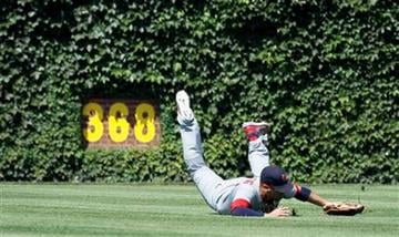 St. Louis Cardinals center fielder Allen Craig makes a diving catch on a line drive by Chicago Cubs' Jeff Baker during the third inning of a baseball game Friday, Aug. 19, 2011 in Chicago. (AP Photo/Charles Rex Arbogast) By Charles Rex Arbogast