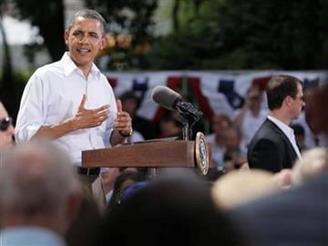 President Barack Obama speaks during a town hall meeting at Lower Hannah's Bend Park in Cannon Falls, Minn.,Monday, Aug. 15, 2011.  (AP Photo/Carolyn Kaster) By Carolyn Kaster