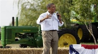 President Barack Obama speaks during a town hall meeting, Wednesday, Aug. 17, 2011, at Country Corner Farm Market in Alpha, Ill., during his three-day economic bus tour.  (AP Photo/Carolyn Kaster) By Carolyn Kaster