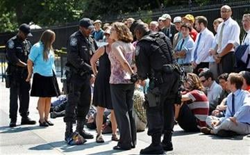 U.S. Park Police officers handcuff and arrest protestors over a proposed pipeline to bring tar sands oil to the U.S. from Canada, in front of the White House in Washington, Saturday, Aug. 20, 2011.    (AP Photo/Manuel Balce Ceneta) By Manuel Balce Ceneta