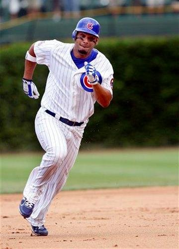 Chicago Cubs's Carlos Pena heads for third base with a triple in the fourth inning of a baseball game against the St Louis Cardinals on Saturday Aug. 20, 2011 in Chicago. (AP Photo/Charles Cherney) By Charles Cherney