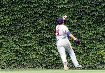 The St Louis Cardinals center fielder Jon Jay can't get to ball hit by the Chicago Cubs' Carlos Pena that went for a triple in the fourth inning of a baseball game on Saturday Aug. 20, 2011 in Chicago. (AP Photo/Charles Cherney) By Charles Cherney