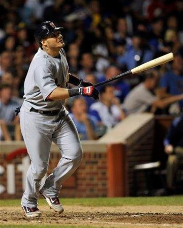 St. Louis Cardinals' Yadier Molina watches his two run home run against the Chicago Cubs during the sixth inning of a baseball game Sunday, Aug. 21, 2011, in Chicago. (AP Photo/Jim Prisching) By Jim Prisching