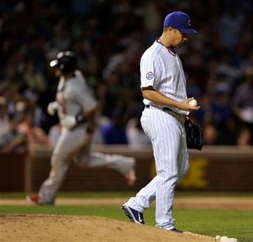 St. Louis Cardinals' Albert Pujols, left, rounds the bases after his solo home run as the Chicago Cubs' pitcher Rodrigo Lopez reacts during the fifth inning of a baseball game Sunday, Aug. 21, 2011, in Chicago. (AP Photo/Jim Prisching) By Jim Prisching