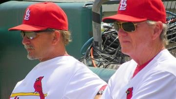 Cardinals pitching coach Dave Duncan (right) and bench coach Joe Pettini (left) watch Chris Carpenter warm up before Thursday's game featuring the Cardinals and the New York Mets. By Lakisha Jackson