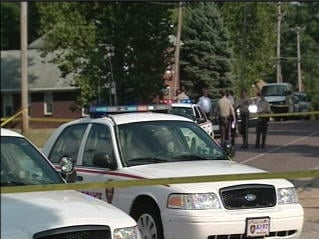 St. Louis County police on the scene of the shooting in Jennings. By Bryce Moore