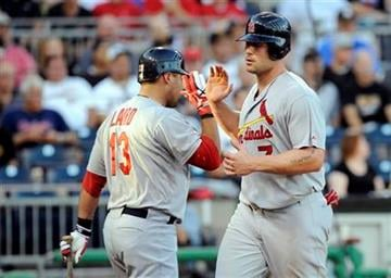 St. Louis Cardinals' Matt Holliday (7) celebrates with Gerald Laird (13) after scoring on a base hit by Skip Schumaker (not pictured) during the second inning of a baseball game Tuesday, Aug. 16, 2011 in Pittsburgh.(AP Photo/Don Wright) By Don Wright