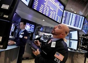 Trader Vincent Napolitano, right, works on the floor of the New York Stock Exchange Monday, Aug. 22, 2011. (AP Photo/Richard Drew) By Richard Drew