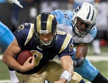 St. Louis Rams quarterback Sam Bradford, left, is sacked for a 10-yard loss by Tennessee Titans Will Witherspoon during the second quarter of an NFL football game Saturday, Aug. 20, 2011, in St. Louis. (AP Photo/Seth Perlman) By Seth Perlman