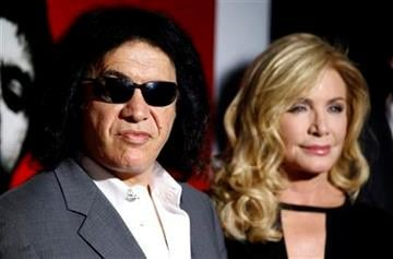 """Gene Simmons, left, and Shannon Tweed arrive at """"Scarface"""" Legacy Celebration Event in Los Angeles, Tuesday, Aug. 23, 2011. """"Scarface"""" will be released on Blu-ray Sept. 6, 2011.  (AP Photo/Matt Sayles) By Matt Sayles"""
