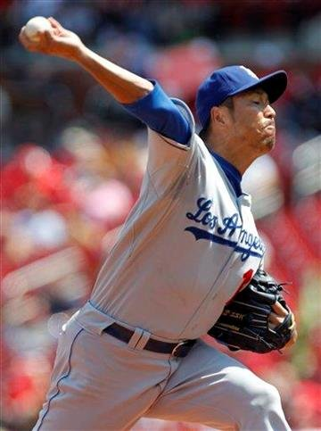 Los Angeles Dodgers starting pitcher Hiroki Kuroda, of japan,  throws during the first inning of a baseball game against the St. Louis Cardinals Wednesday, Aug. 24, 2011, in St. Louis. (AP Photo/Jeff Roberson) By Jeff Roberson