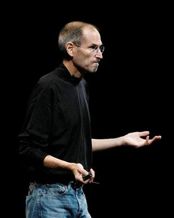 Apple CEO Steve Jobs gestures to attendees to turn off their Wi-Fi as he has problems demonstrates the new iPhone 4 during the Apple Worldwide Developers Conference, Monday, June 7, 2010, in San Francisco. (AP Photo/Paul Sakuma) By Paul Sakuma