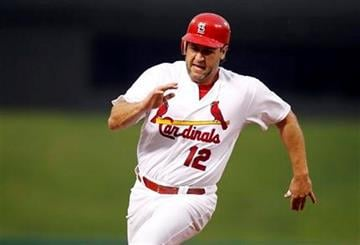 St. Louis Cardinals' Lance Berkman rounds third and heads home to score on a single by David Freese during the second inning of a baseball game against the Colorado Rockies, Friday, Aug. 12, 2011, in St. Louis. (AP Photo/Jeff Roberson) By Jeff Roberson
