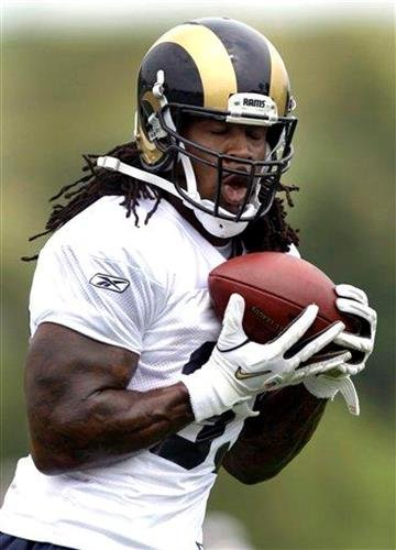 St. Louis Rams running back Steven Jackson catches a pass during NFL football training camp Saturday, July 30, 2011, at the Rams' training facility in St. Louis. (AP Photo/Jeff Roberson) By Jeff Roberson