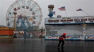 NBC reporter Peter Alexander attempts to broadcast from the windswept Coney Island boardwalk in New York as Hurricane Irene became intensified Sunday, Aug. 28 2011 in Coney Island section of  New York. (AP Photo/Craig Ruttle By Craig Ruttle