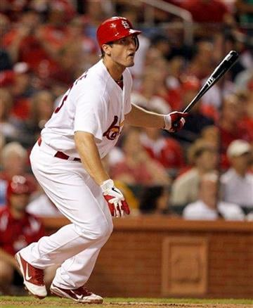 St. Louis Cardinals' David Freese hits a two-run single during the fifth inning of a baseball game against the Pittsburgh Pirates, Thursday, Aug. 25, 2011, in St. Louis. (AP Photo/Jeff Roberson) By Jeff Roberson