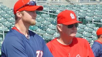 Cardinal pitching coach Dave Duncan shares a moment with his son Chris before Wednesday's Nationals/Cardinals game. By Lakisha Jackson