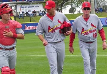 Cardinals pitcher Adam Wainwright walks with catcher Matt Pagnozzi and pitching coach Dave Duncan before Friday's game featuring the Cardinals and the Washington Nationals. (Brendan Marks/KMOV) By Lakisha Jackson