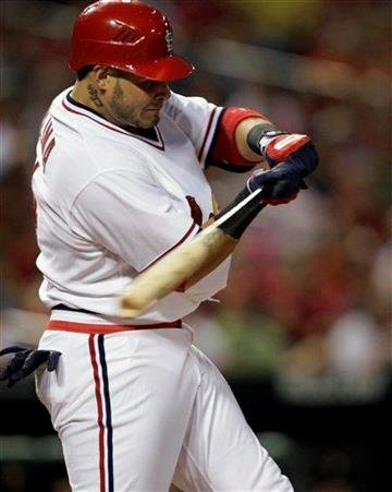 St. Louis Cardinals catcher Yadier Molina swings for a three-run homer in the second inning of a baseball game against the Pittsburgh Pirates, Friday, Aug. 26, 2011, in St. Louis. (AP Photo/Tom Gannam) By Tom Gannam