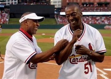 St. Louis Cardinals Hall-of-Famer Ozzie Smith, left, kids around with former teammate Willie McGee a baseball game between the Cardinals and the Pittsburgh Pirates, Friday, Aug. 26, 2011, in St. Louis. (AP Photo/Tom Gannam) By Tom Gannam