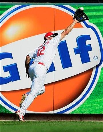 St. Louis Cardinals right fielder Lance Berkman chases down a fly ball during the third inning of a baseball game against the Pittsburgh Pirates, Saturday, Aug. 27, 2011, in St. Louis. (AP Photo/Jeff Curry) By Jeff Curry