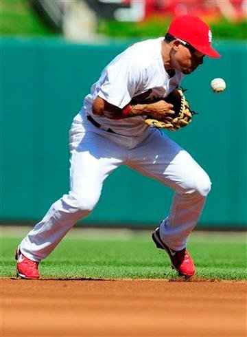 St. Louis Cardinals shortstop Rafael Furcal makes an error on a ground ball hit by Pittsburgh Pirates' Alex Presley during the first inning of a baseball game on Saturday, Aug. 27, 2011, in St. Louis. (AP Photo/Jeff Curry) By Jeff Curry