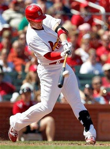 St. Louis Cardinals' Allen Craig hits a sacrifice fly to score Kyle Lohse during the fourth inning of a baseball game against the Pittsburgh Pirates, Sunday, Aug. 28, 2011, in St. Louis. The Cardinals won 7-4. (AP Photo/Jeff Roberson) By Jeff Roberson