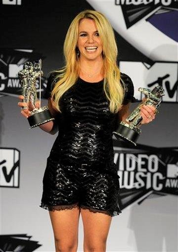 Britney Spears poses with the video vanguard award backstage at the MTV Video Music Awards on Sunday Aug. 28, 2011, in Los Angeles.(AP Photo/Chris Pizzello) By Chris Pizzello