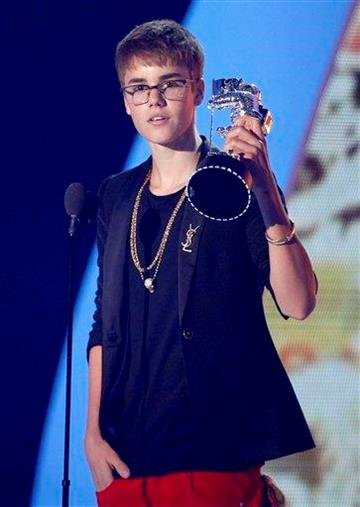 "Justin Bieber accepts the award for best male video for ""U Smile"" at the MTV Video Music Awards on Sunday Aug. 28, 2011, in Los Angeles. (AP Photo/Matt Sayles) By Matt Sayles"