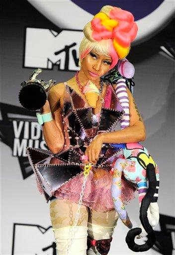 "Nicki Minaj poses backstage with the award for best hip-hop video for ""Super Bass"" at the MTV Video Music Awards on Sunday Aug. 28, 2011, in Los Angeles.(AP Photo/Chris Pizzello) By Chris Pizzello"