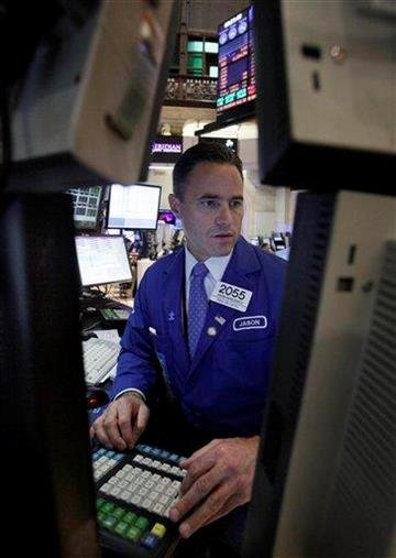 Specialist Jason Hardzewicz works at his post on the floor of the New York Stock Exchange Monday, Aug. 29, 2011. (AP Photo/Richard Drew) By Richard Drew