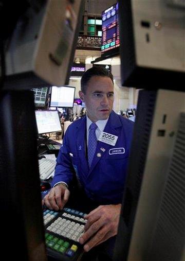 Specialist Jason Hardzewicz works at his post on the floor of the New York Stock Exchange Monday, Aug. 29, 2011. (AP Photo/Richard Drew) By Richard Drew