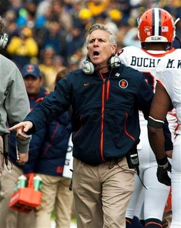 Illinois head coach Ron Zook shouts at his players from the sideline during the second quarter of an NCAA college football game, Saturday, Nov. 6, 2010, in Ann Arbor, Mich. Michigan won 67-65 in triple overtime. (AP Photo/Tony Ding) By Tony Ding
