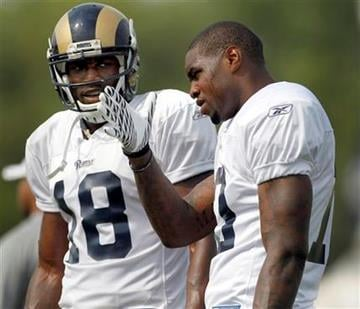 St. Louis Rams wide receivers Joe West, left, and Mike Sims-Walker talk between drills during NFL football training camp on Thursday, Aug. 4, 2011, at the Rams' training facility in St. Louis. (AP Photo/Jeff Roberson) By Jeff Roberson